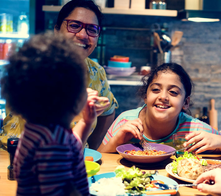 LNG providing clean energy to power home while family eats a meal