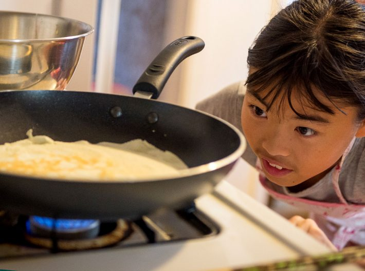 LNG providing clean energy to provide gas in home while family cooks