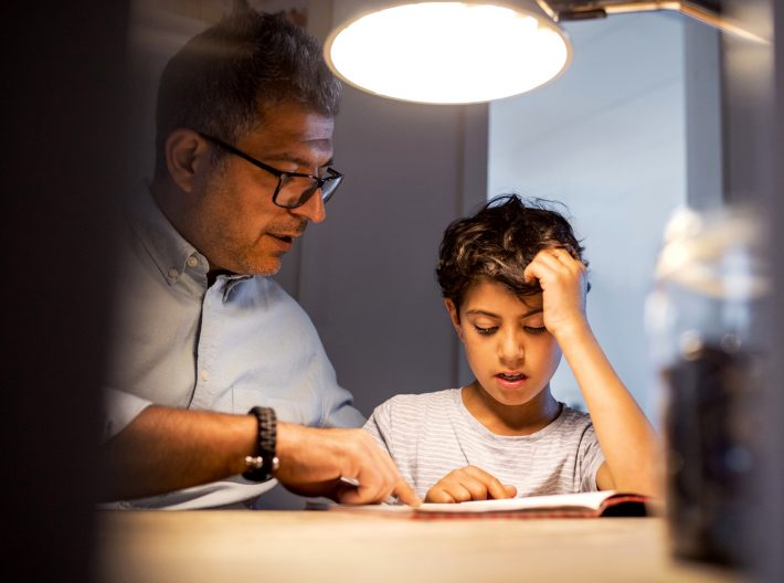 Clean energy LNG providing a supply of energy to power home while man and child read