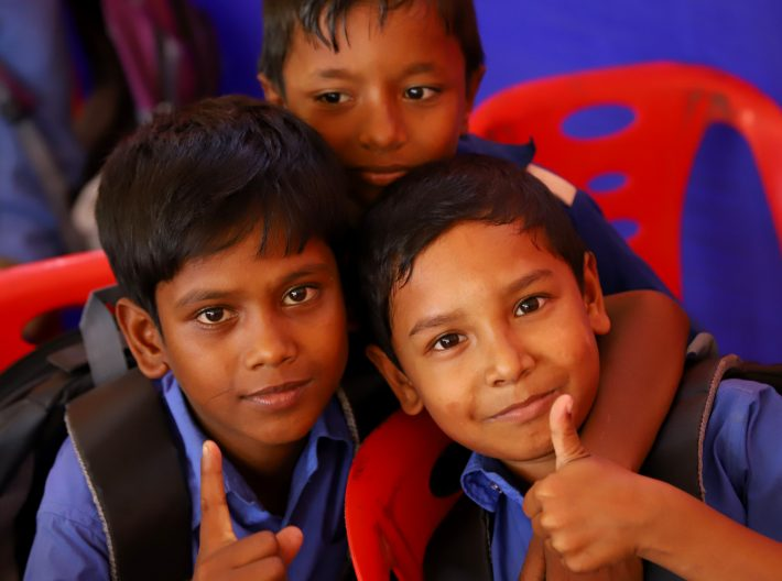 happy children giving the thumbs up