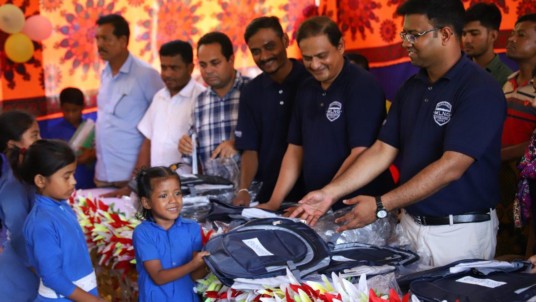 Excelerate employees distributing backpacks in Bangladesh