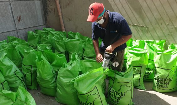 Worker packing donations for COVID-19 food relief
