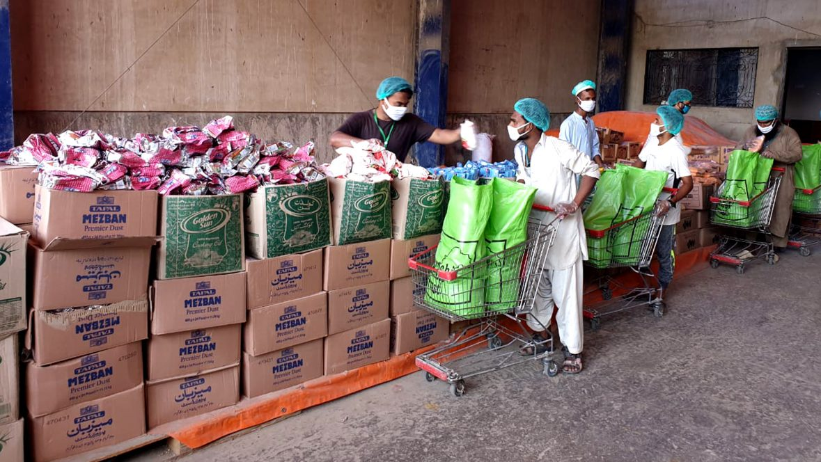 Workers packing donations for COVID-19 food relief